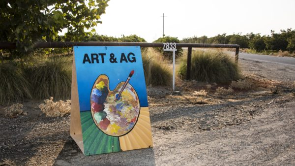 Art and Ag sign depicting a painters pallet and crop rows