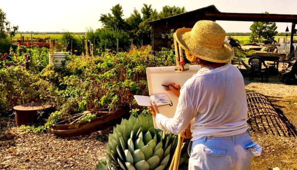 Artist painting at the farm